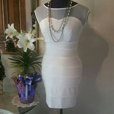 Light cream bodycon dress Dress up for that special occasion  with this very light cream bodycon dress. Sweet Storm Dresses