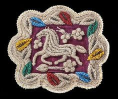 "A beaded mat with horse image, part of the Iroquois Indian Museum's exhibit ""Birds and Beasts in Beads: 150 Years of Iroquois Beadwork."" (photo: Warren Wheeler)"