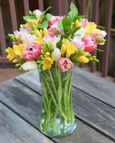 Tulips and freesias flower arrangement. Freesia Bouquet, Freesia Flowers, Memorial Flowers, Beautiful Flowers Wallpapers, Flower Meanings, Spring Wedding Flowers, Floral Arrangements, Flower Arrangement, Pretty Flowers