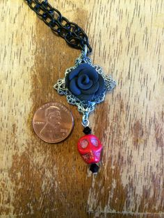 Black Rose and Skull Necklace by RhinoAccessories on Etsy