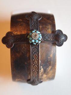 Oxidized cross cuff bracelets.
