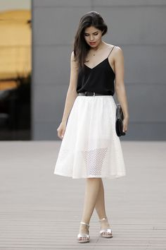 Team a black silk tank with a white eyelet skater skirt for a lazy Sunday…