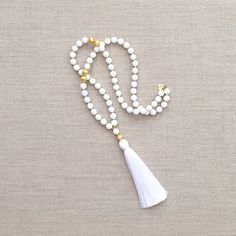 A Loves Affect Original The LoryTassel Necklace is composed of 10mm white agate, gold brushed accent beads and a 5 silk tassel in white. Necklace is