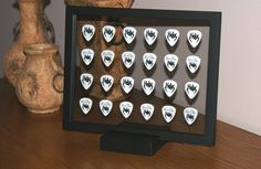 guitar pick display. I love that you can see both sides of the picks!
