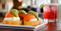 Cielo's bruschetta nearly look like gorgeous sushi. Each of the four bites begins with a base of garlic baguette. Layered bottom to top is pesto, a quenelle of mild goat cheese and an oven-dried tomato over the top. (Photo by J. Pollack Photography)