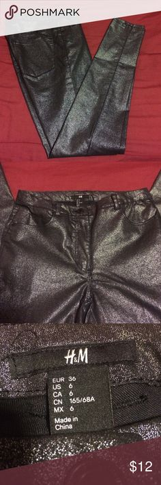 """H&M Pants Silver, black, shiny pants, size 6. Pants fit more like a 2 or 4. Pants are high waisted and super comfortable. Can be dressed up with heels or down with boots and a sweater! Worn 3-4x and in mint condition. Flat waist measures approximately 13"""" and rise measures 9"""". Inseam measures 30"""". H&M Pants Skinny"""