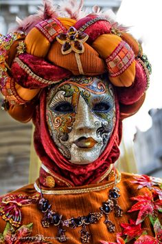 Balori mask. Also a good idea of the fully covering clothing commonly worn among the society