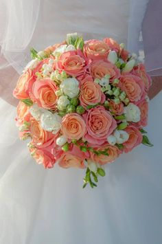 Coral and white wedding bouquet, featuring miss piggy roses, with bouvardia, spray white roses and fragrant freesias www.entirelybridal.co.uk www.facebook.com/entirelybridal