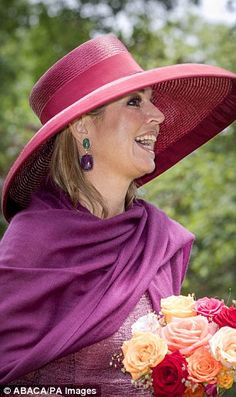 The royal was all smiles as she looked out from beneath her bright purple wide brimmed hat
