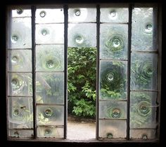 Bullseye glass window    In the garden buildings at Calke Abbey, Derbyshire, England