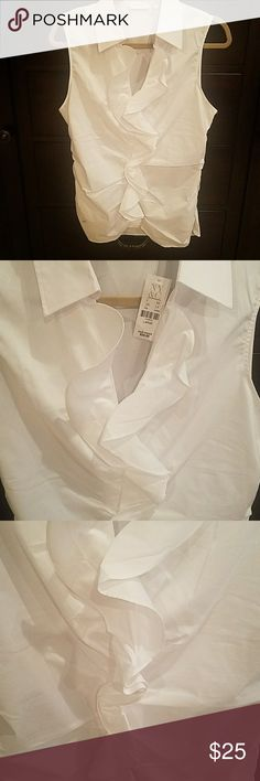 NWT white sleeveless blouse. Beautiful on! Form fitted with row of ruffles that go down the center of the shirt. Beautiful!! Great under a blazer, or by itself. New York & Company Tops Blouses