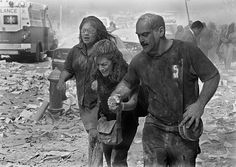 Sheet metal installer Joseph Rabito and two women help each other through dust, ash and debris after the terrorist attack that destroyed the World Trade Center Sept. 11, 2001. Rabito rushed to ground zero when he heard about the attacks.