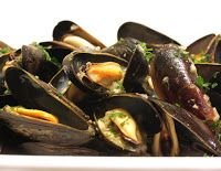 Spicy Steamed Mussels in a Creamy Wine Sauce - the sauce is simply addicting
