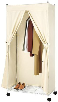 Whitmor Supreme Garment Rack Cover - Recommended by Martha Stewart.  I have 3 of these in the basement.  Had no idea you were not supposed to use plastic.