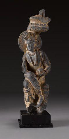 A schist figure of an attendant Gandhara, 2nd century