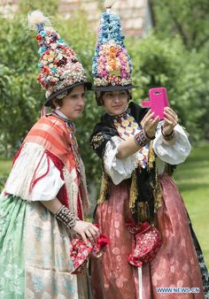 Young girls wearing traditional folk costumes perform during the annual Ljelje Procession in Gorjani, Eastern Croatia, May 24, 2015.
