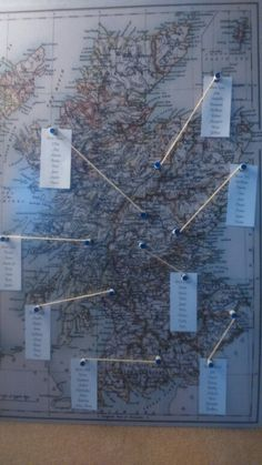 Map seating plan. We decided our tables would be named after Salmon fishing rivers in Scotland. So I found a poster of a map online and I went to the local framers who mounted it on a sticky board. I printed out the seating plan and cut them to size, making a hole with a punch. I pinpointed the rivers using notice board pins and glued string around them. I then pinned on the table plan and glued the other end of the string onto the pin, cutting of the excess. *TIP* glue the tip of the pins…