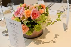 Lovely centerpieces from a San Francisco charity gala with peonies, ranunculus, tulips, and vibernum at the Sir Francis Drake.  #pink #peach #weddingcolors