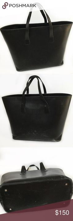 "Bally Switzerland black leather structured tote Authentic Bally Switzerland black leather tote. Structured, holds its shape. Multiple inside zip compartments. Scuffs on leather, as shown in photos. Clean interior, lined in fabric. Approx. 11"" x 17"" x 4"". Bally Bags Totes"