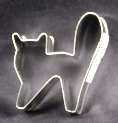This scaredy cat Halloween cookie cutter is made out of metal and painted in all black and will make cat shaped cookies that are tall by wide. This is a fun Halloween cookie cutter. You could also use this to make cookies for the cat lover in your life. Halloween Cookie Cutters, Cat Cookies, Shaped Cookie, How To Make Cookies, Halloween Cat, Black, How To Make Biscuits, Black People