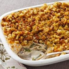 Creamy Stuffing-Topped Turkey Recipe - What a great way to use leftover roasted turkey--bake it with pasta in a creamy herb and garlic sauce with green beans and onion topped with shredded cheese and stuffing.