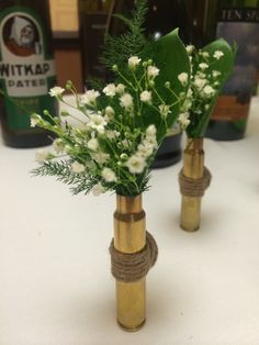 Bullet boutonnieres with burlap and baby's breath.  Magnet used to secure to clothes. By Montana Baskets