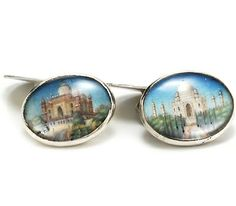 Anglo-Indian Portrait Miniature Silver Cufflinks    This pair of oval double sided silver cufflinks incorporates the rendering of two famous buildings of India. Executed in watercolor assumed on ivory is the depiction of the magnificent Taj Mahal and what may be the Tomb of Safdarjung - a garden tomb in a marble mausoleum built in 1754 in Delhi. All of the portraits are mounted under glass.