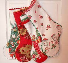 Vintage Christmas fabric stockings.  Love the ruffle on the top one!