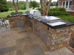 Backyard Kitchen Design Ideas with L Shaped Table Furniture and Amazing Stone Floor Decorating also Black Tiles Countertop for the Best Outdoor Kitchen Collection Outdoor Kitchen Plans, Outdoor Kitchen Countertops, Backyard Kitchen, Outdoor Kitchen Design, Backyard Patio, Outdoor Kitchens, Corian Countertops, Backyard Barbeque, Kitchen Grill