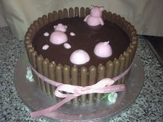 Piggy Mud Cake - Made with sponge cake, chocolate fingers & chocolate fudge icing with sugar paste piggies :D