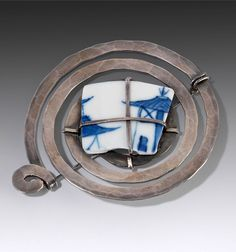 Brooch | Alexander Calder.    Silver, steel and ceramic.  ca. 1940 | 93,940€ ~ sold (June '14)