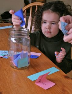 """Story Jar: On small slips of paper, write words either in English or another language, if you are a parent of a bilingual child. Fold the slips in half, and place them in a jar. They can be any words, such as """"elephant,""""""""castle,"""" """"orange,"""" """"milk,"""" """"dog,"""" or """"princess"""" that would work well to make up a story. Have your child draw three slips of paper at a time, then make up a story with your child's help using the words that you drew."""
