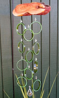 Recycled wine bottle wind chime, Juniper wood, green, circle glass wind chime, Yard decor, yard art on Etsy, $40.00