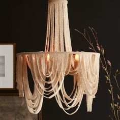 Chandelier is fully beaded with tiny coco beads in a soft white finish complete with a cream finished chain and canopy for hanging Unique Lamps, Unique Lighting, Home Lighting, Chandelier Lighting, Lighting Design, Custom Drapes, Beaded Chandelier, Luminaire Design, Decoration