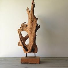 Striking driftwood sculpture will look stunning in any room or decor! Rustic to Modern, this sculpture would display nicely on any table or credenza. Heavy at 12 1/2 lbs. The dimension of the base is