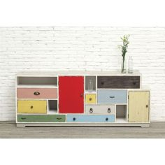 An array of drawers and doors marks this quirky, cheerful sideboard. The many-colored piece is perfect for eclectic interiors that need multi-purpose storage.