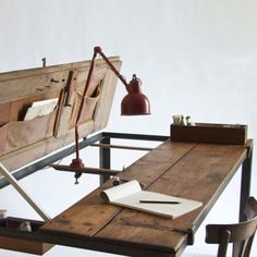 I want to create a desk similar to this that allows you to drop the table down from the wall, so the items hanging in the pockets are hidden from eager little hands.  I would probably design the whole thing to be only eighteen inches high, so it would not be a deep desk, but with a laptop, you don't need a deep desk.  I think I'd rather have a laptop from now on anyway.  They are making them more durable than they used to be.