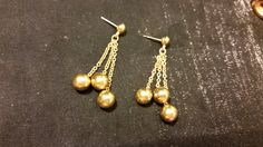 Vintage 80-90's Gold Tone Shiny Triple Chain And Ball Dangle Pierced Earrings by thelovelaceplace on Etsy https://www.etsy.com/listing/248335929/vintage-80-90s-gold-tone-shiny-triple
