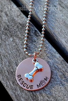 """Show everyone that you saved a life! This beautiful handstamped necklace is made with a 1"""" round copper disk accented with a silver dog bone. It is on a 24"""" silver ball chain. 10% of proceeds will go to a local animal shelter. Get yours today!!"""