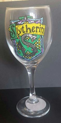 Slytherin House from Harry Potte, hand painted wine glass    For more information and to place custom orders, visit my page https://www.etsy.com/uk/shop/KelMacDesigns