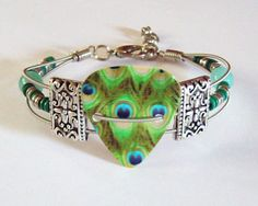 Recycled Guitar String Peacock Guitar Pick by StrungUpJewelry