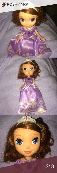 Disney Princess Sofia The First Doll Removable shoes. Removable necklace (amulet of Avular) brushable hair , she can stand up or sit down. And her dress can be taken off to put on other clothes for her (coming soon to my closet:) great for your princess obsessed daughter (or son) great for role play Disney Other