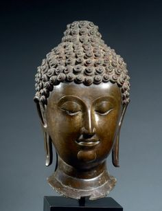 Head of Buddha Thailand, Lan Na Kingdom 14th century Bronze, cast in the lost wax method Height 45 cm