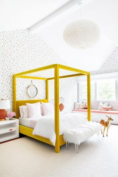 At the Silo Ridge Farmhouse by Chango & Co., a cheery yellow canopy bed by Jayson Home and dotted wallpaper from Brewster Home create a vibrant girl's bedroom. #dwell #howtodesignakidsroom #kidsroom #moderndesign #howto #diy #designtips Bedroom Inspo, Bedroom Decor, Bedroom Ideas, Lego Bedroom, Bedding Decor, Rustic Bedding, Chic Bedding, Bedroom Wall, Wall Decor