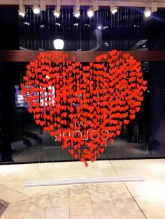 Hanging paper hearts are a cheap way to draw attention to your Valentines Display