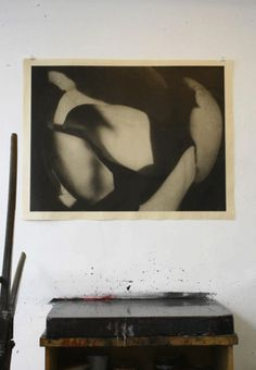 Magnolia, hanging over ink block in March exhibit of Farhad Ostovani at shop. A photogravure lithograph; an edition of 7.  Michael Woolworth Publications
