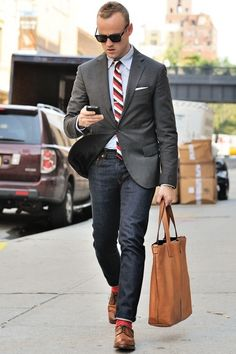 Shop this look for $259: http://lookastic.com/men/looks/socks-and-derby-shoes-and-jeans-and-blazer-and-pocket-square-and-dress-shirt-and-tie/1527 — Red Socks — Brown Leather Derby Shoes — Navy Jeans — Charcoal Blazer — White Pocket Square — Grey Dress Shirt — White and Red Vertical Striped Tie