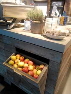 Coffee Shop, Eindhoven Airport. Fresh Fruits Display for take away wooden apples