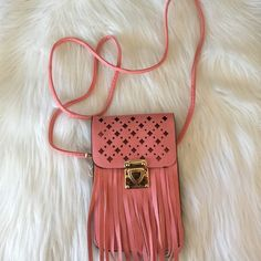 ⭐️SALE⭐️PINK FRINGE CELLPHONE CROSSBODY ⭐️ Brand new !  Perfect for festivals/ concerts Can fit an iPhone 6 plus✨ 2 compartments for phone or cards , money.   ‼️firm price for free ship  ‼️ships tmw morning Accessories Phone Cases