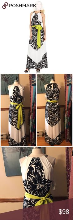 $289 NWT Vince Camuto Floral Chevron Maxi Dress Size 8. Black & white floral & chevron stripe maxi dress with neon sash. Elastic at waist. Keyhole button enclosure in back. Lined bodice. Polyester, spandex. NWT $289 Vince Camuto Dresses Maxi